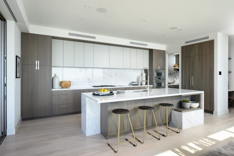 Kitchen with Light Wood Floors and White Counters