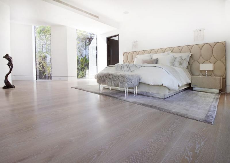 Wood Flooring in Open Bedroom with Light Walls