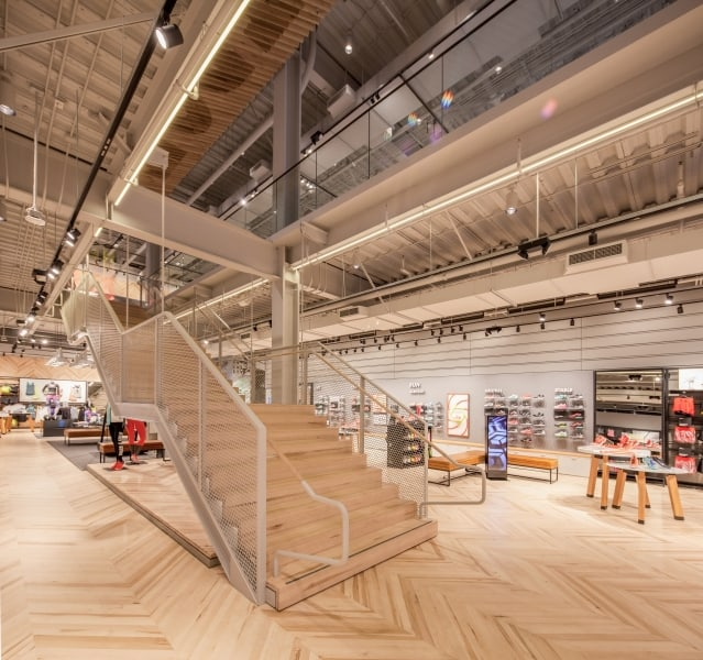 Open Modern Wood Stairs in Athletic Store