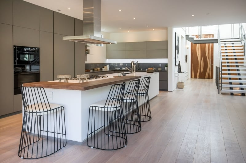 Modern Kitchen with Wood Flooring and Stairs