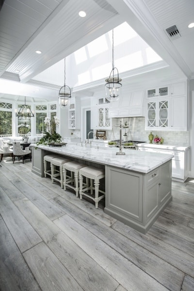 Luxury Kitchen with Grey Wood Flooring and White Counters